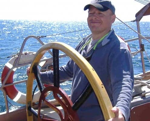 Richard at the helm of the schooner Trinovante.