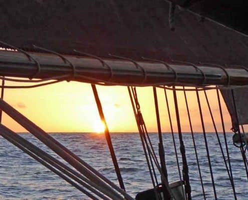 At sea offshore sailing at sunrise.