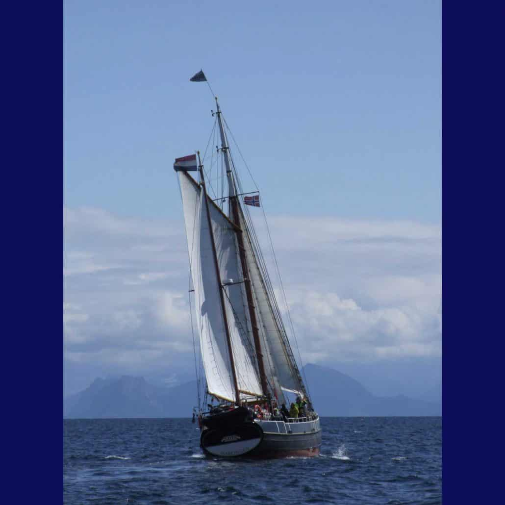 Dutch Ketch The Bor photographed stern on off Svolver, Lofoten, Norway. SchoonerSail Tall Ships Gallery.