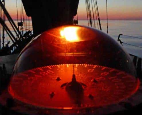 The ships compass it up at night on an offshore voyage