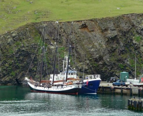 The Fair Isle ferry and the schooner Trinovante in harbour. Taken after Orkney sailing.