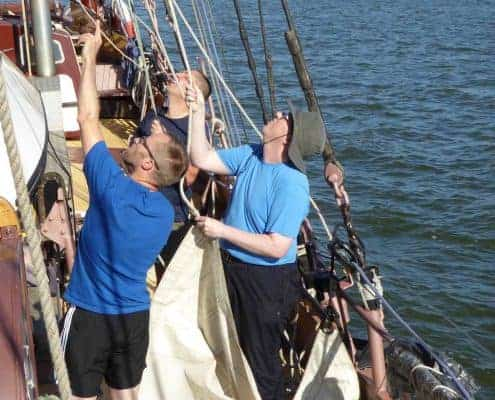 Hoisting a topsail on a schoonersail tall ship adventure sailing holiday