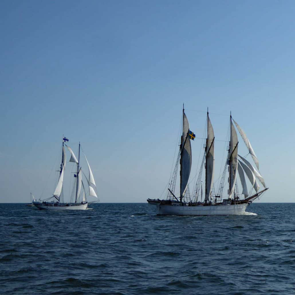 The Finnish two masted schooner Joanna Saturna overtakes the Swedish three master INGO at the start of the Baltic Sea Tall Ships Race from Klaipeda to Szczecin in 2017. SchoonerSail Tall Ships Gallery.