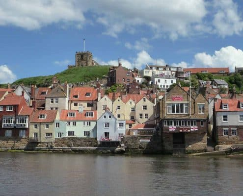 Whitby harbour as seen from a boat.