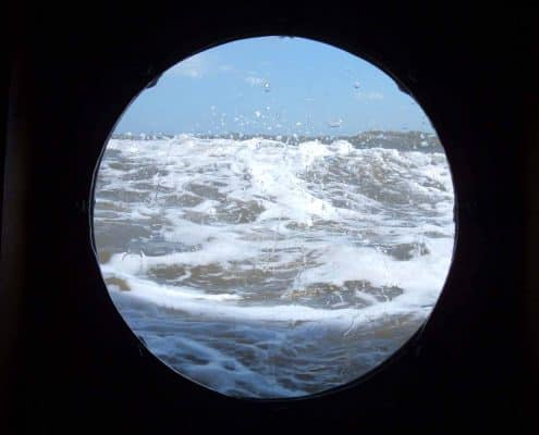 View through a port hole of the sea - taken on a UK Sailing Holiday.