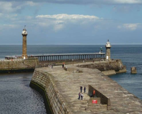 The massive stone breakwaters at the entrance to Whitby harbour.