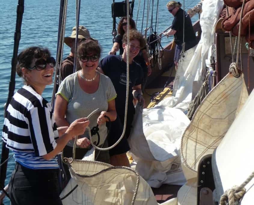 Getting ready to set the topsail on a schooner.