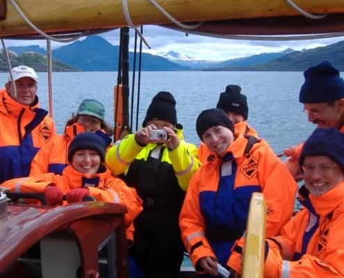 A schooner crew group photo - taken while sailing above the Arctic Circle Norway.