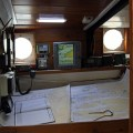 Chart table on the schooner Trinovante.