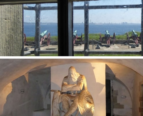 Looking out of a window atcacnnon pointing over Oresund sound from Kronborg castle and the Holger Danske statue in the cellar
