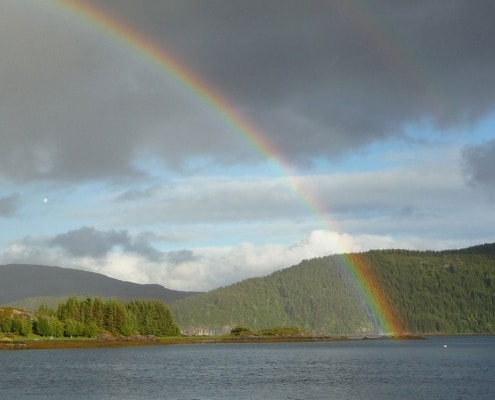 A rainbow appears over Swedish islands during a sailing holiday.