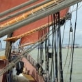 The three masted schooner Trinovante sailing into Harwich, UK - a view taken through the sails.