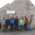 The crew of Trinovante outside the shop on Out Skerries, Shetland.
