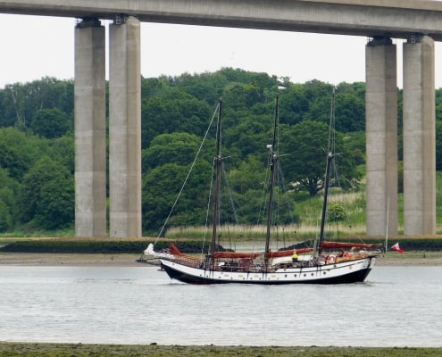 The schooner Trinovante motors under the Orwell Bridge