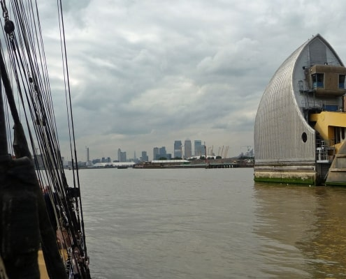 The Thames barrier seen from the deck of a sailing ship