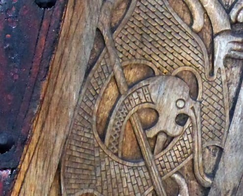 Detail of a carving on a replica viking ship. Norway