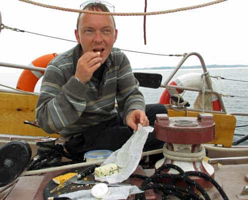 Eating Danish cheese on a tall ship