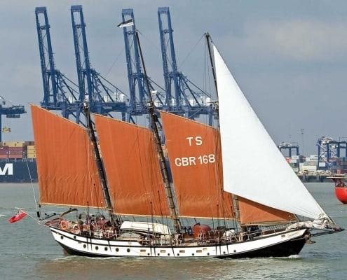 UK Sailing Weekends, the schooner Trinovante sailing past Felixstowe Port.