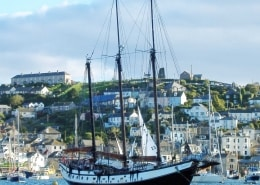 A ship in harbour on one of SchoonerSail's Cornwall sailing holidays.