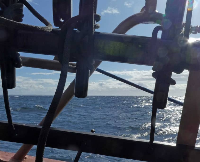 Taken on a UK sailing holiday, schooner Trinovante, a pin rail on a sailing ship with the sea in the background