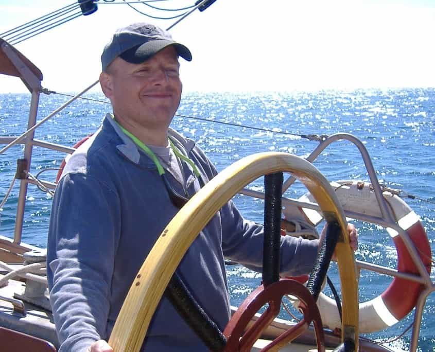 Steering the ship on a sailing holiday in the UK