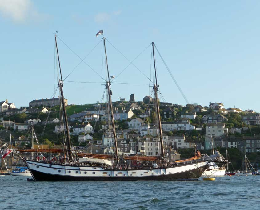 Uk Sailing Holidays - the schooner Trinovante anchored in Fowey